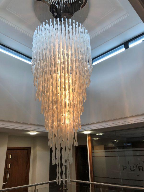 white glass stairwell chandelier